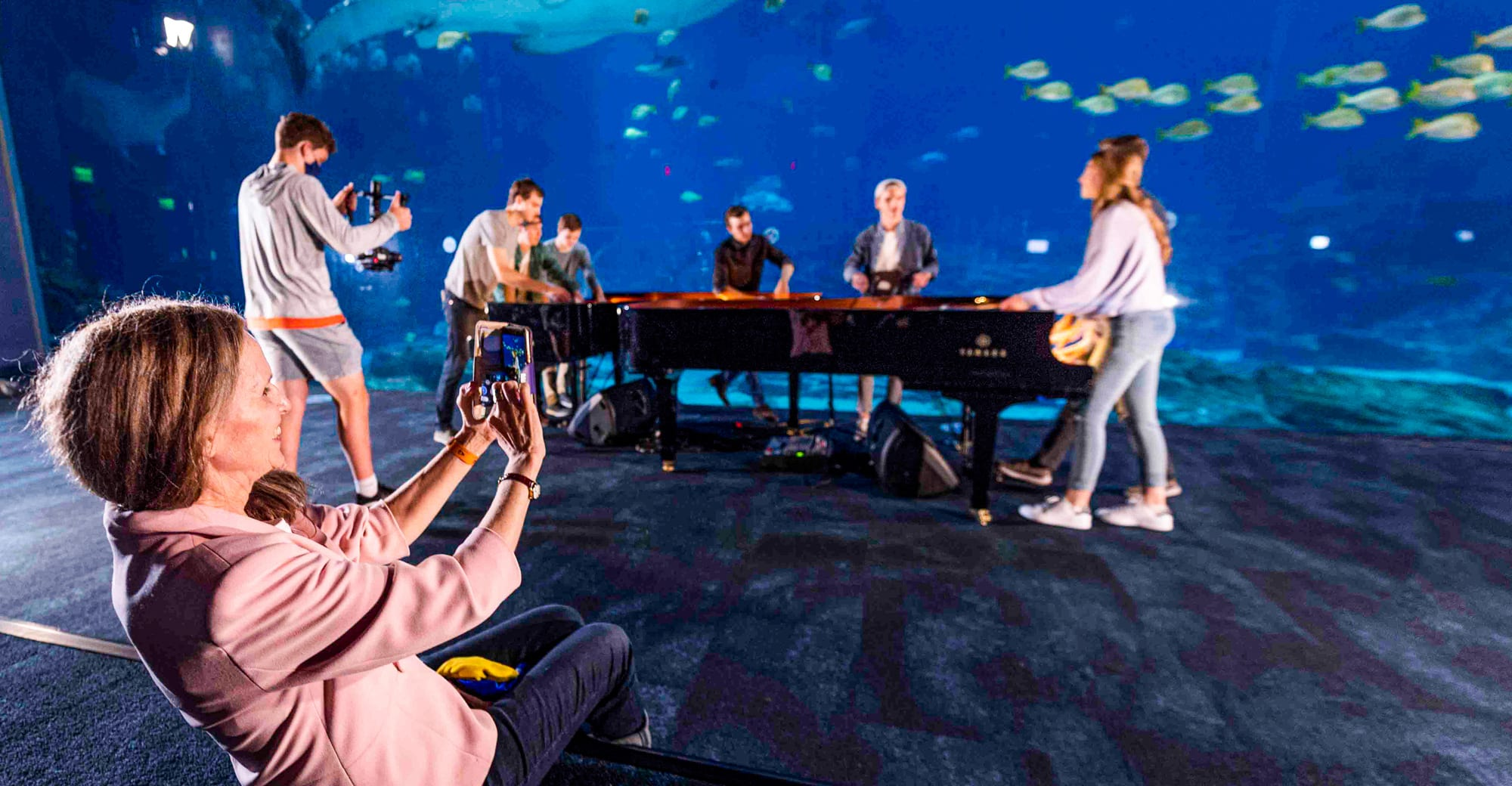 Veda Storey takes a photo of her children performing at the Georgia Aquarium