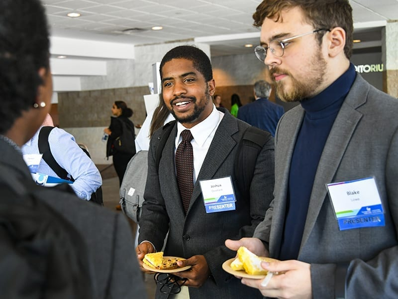 Student presenters mingle during the 2019 Georgia State Undergraduate Research Conference (GSURC)