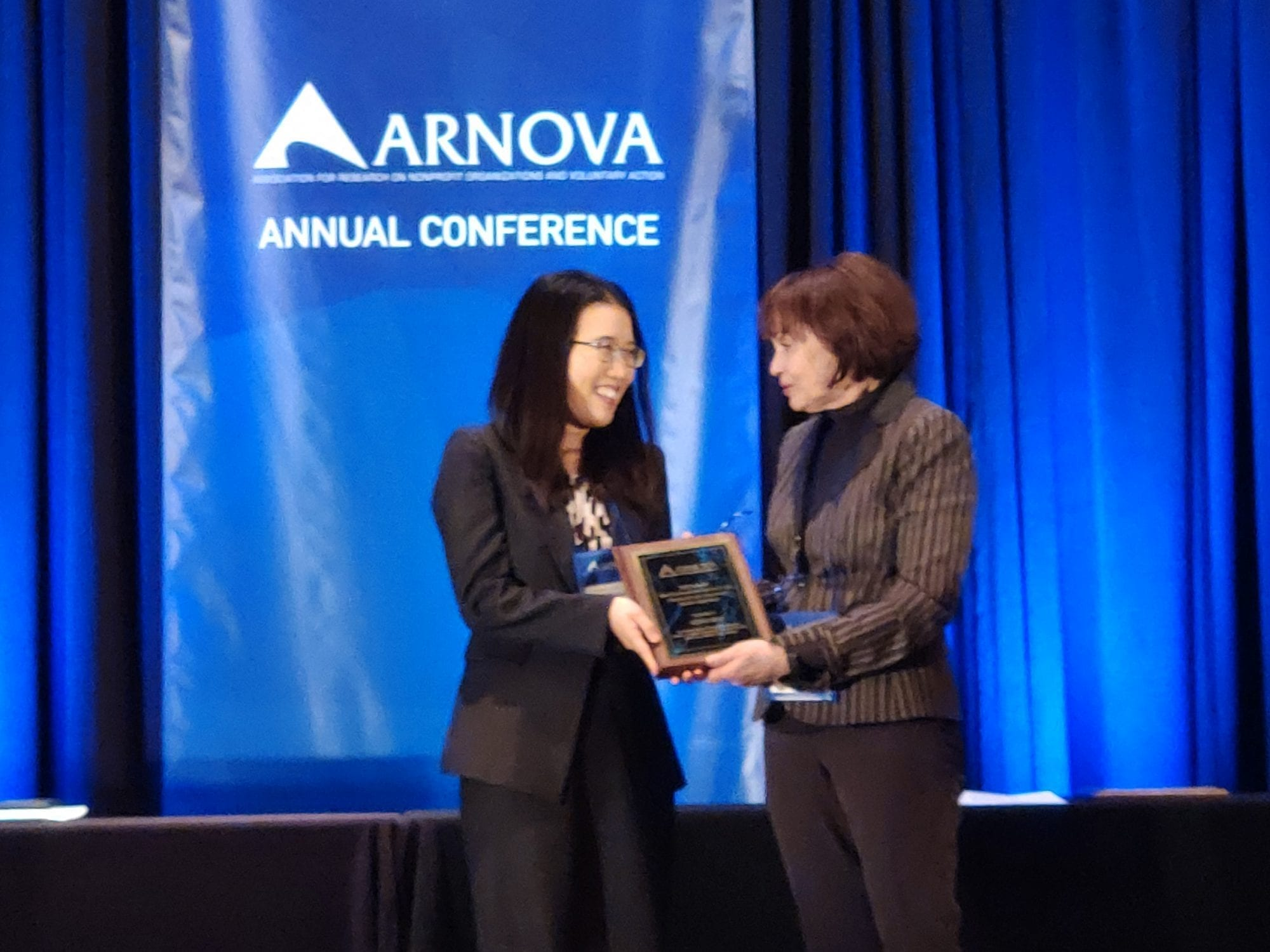 Mirae Kim receiving the Arnova award for Outstanding Nonprofit Research Article of the Year