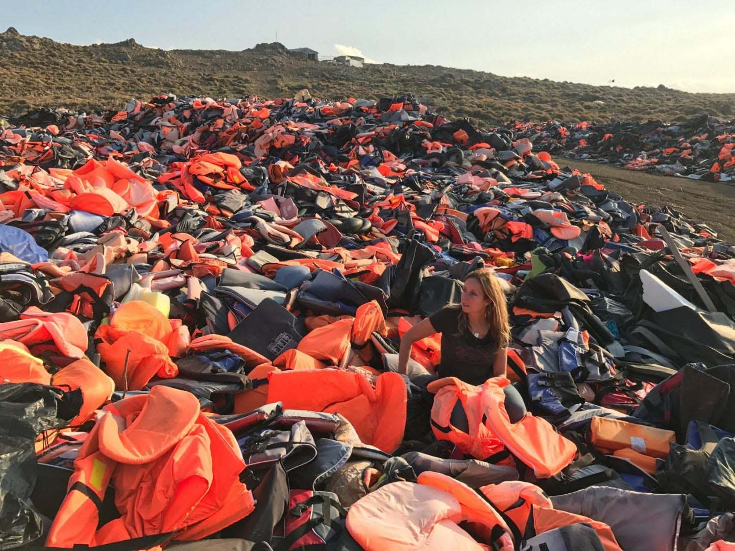 Longobardi sorts through the vast piles of plastic safety gear along the shores of Lesvos. | Photo by Susan Knippenberg