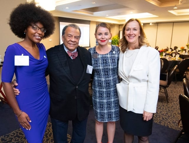 Ambassador Andrew Young with Dean Sally Wallace, Director of Development Amanda Puche and an Andrew Young School student