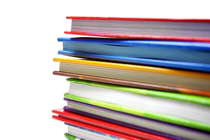 Stack of children's books set against a white background