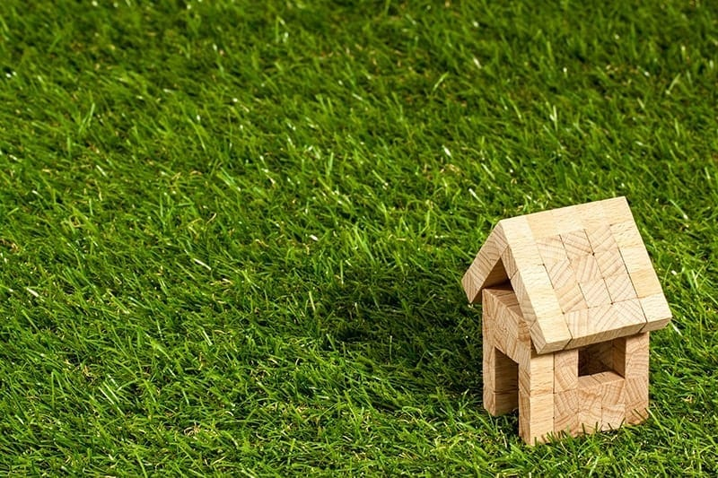 Grass with house of bricks. Implications for fair housing