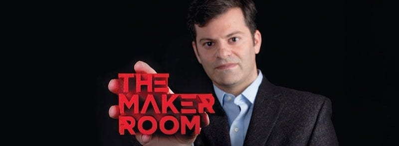 "Jonathan Cohen holds a 3D printout of the words ""The Maker Room"""