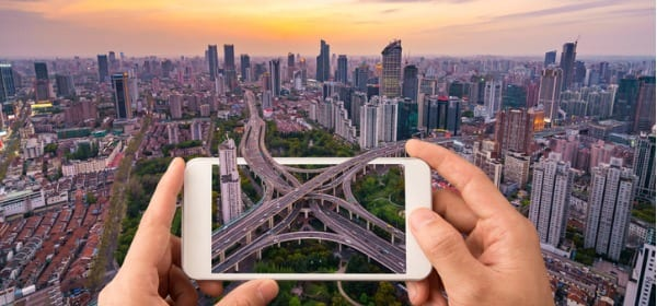 Urban infrastructure viewed through a smartphone