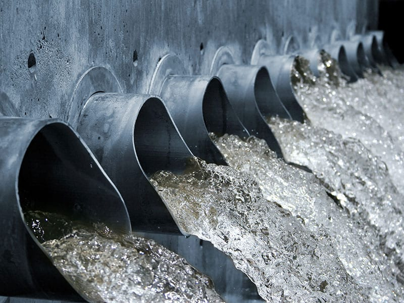 Water pipes channel wastewater into a stream.