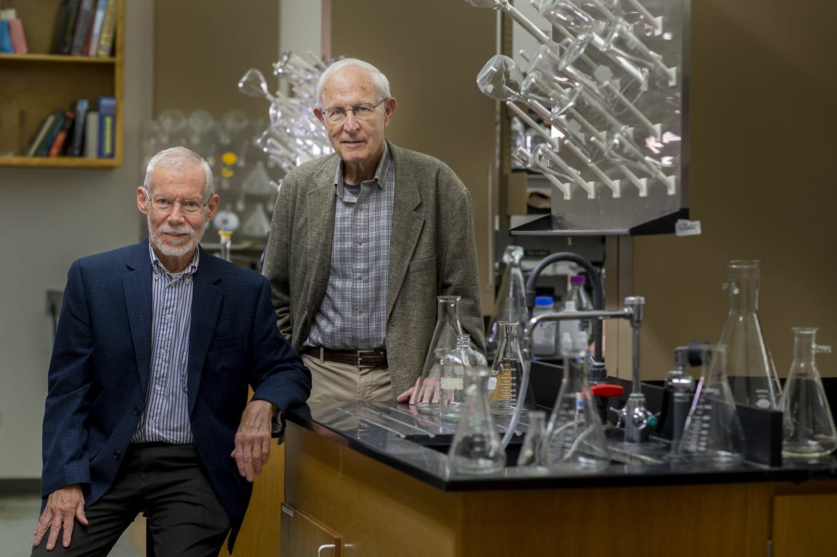 Two older white males in lab