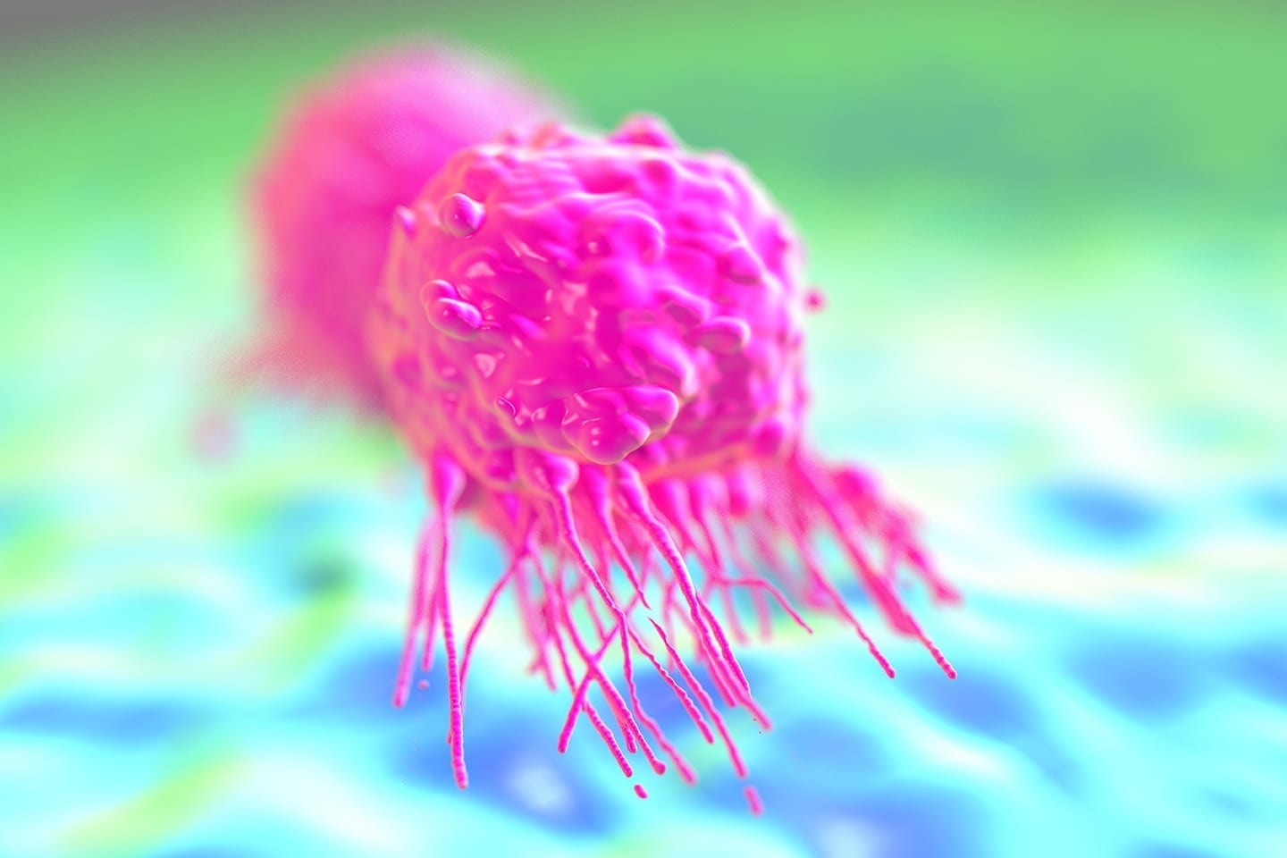 Stock image of pink cancer cell on green and blue background