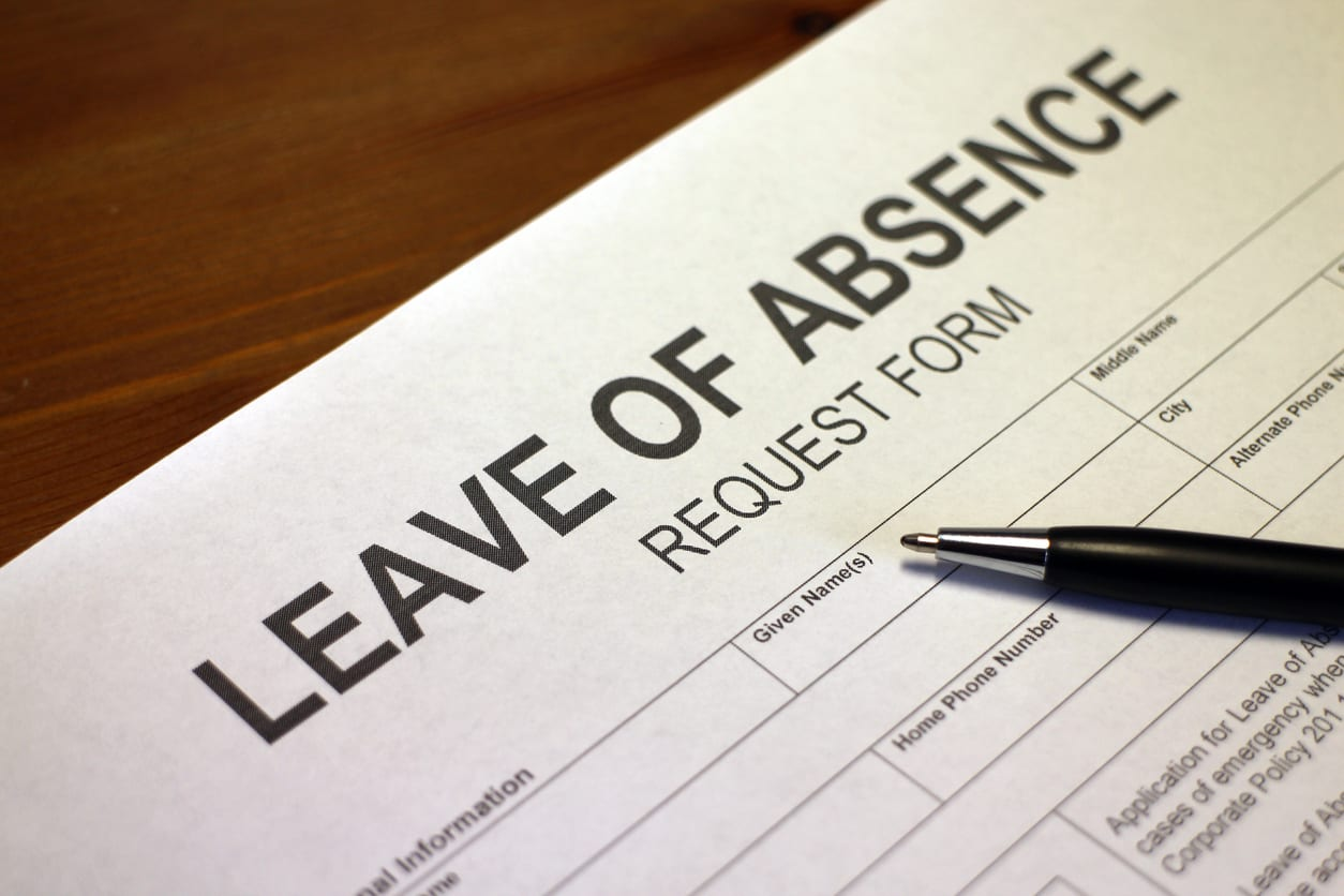 Someone filling out Leave of Absence Request Form.