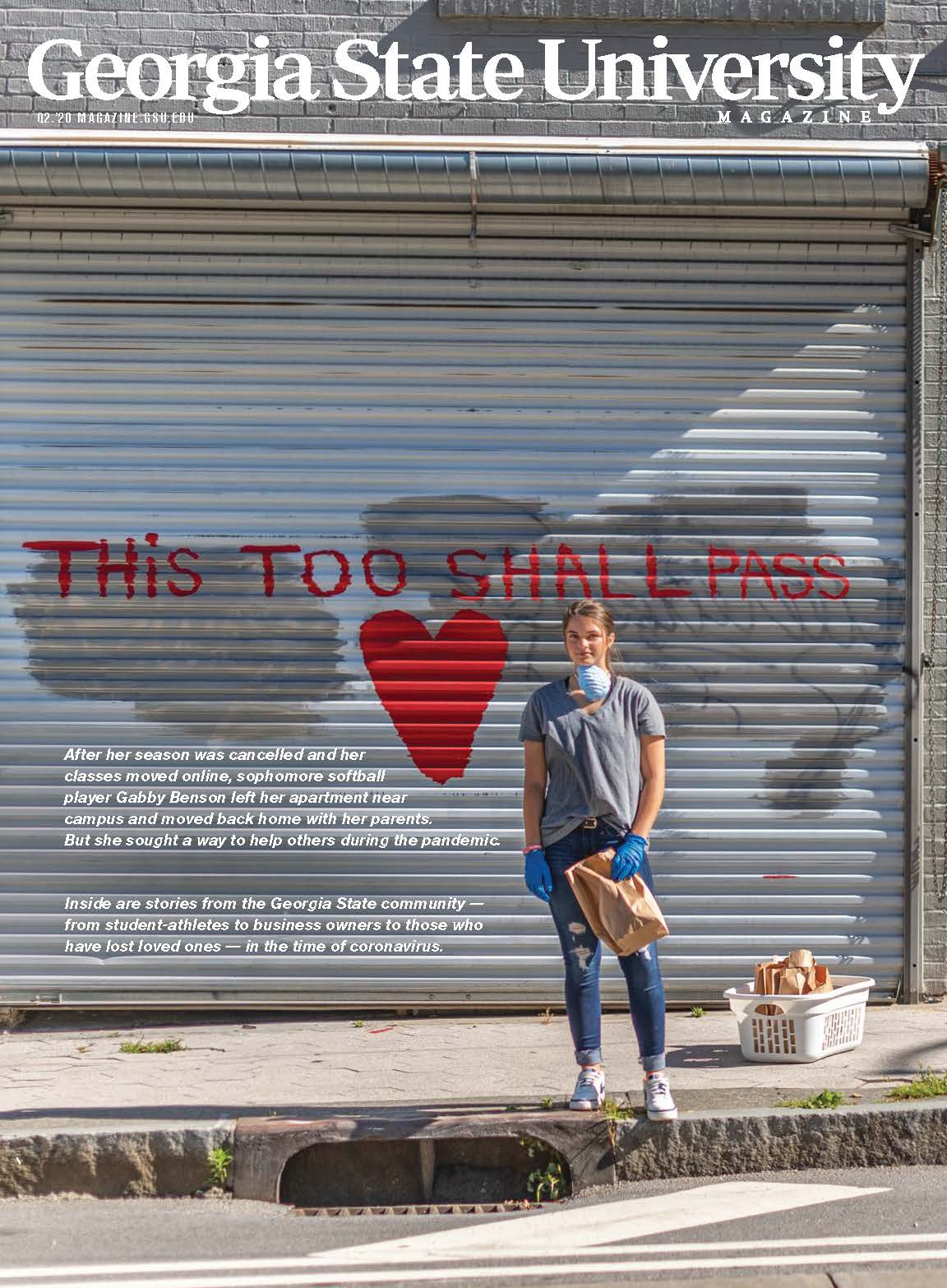 "The cover of the summer issue of Georgia State University Magazine featuring a student in front of a wall painted, ""This Too Shall Pass."""