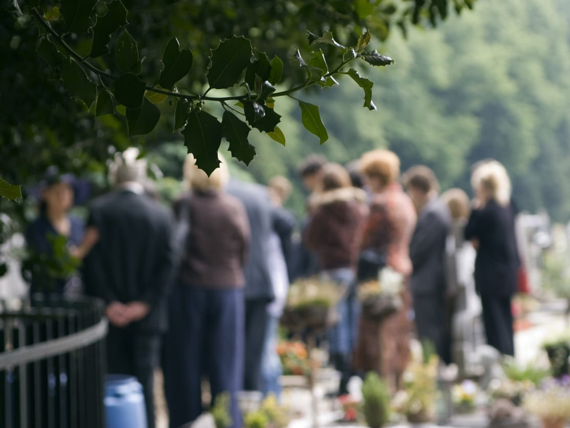 Family of a homicide victim at a burial