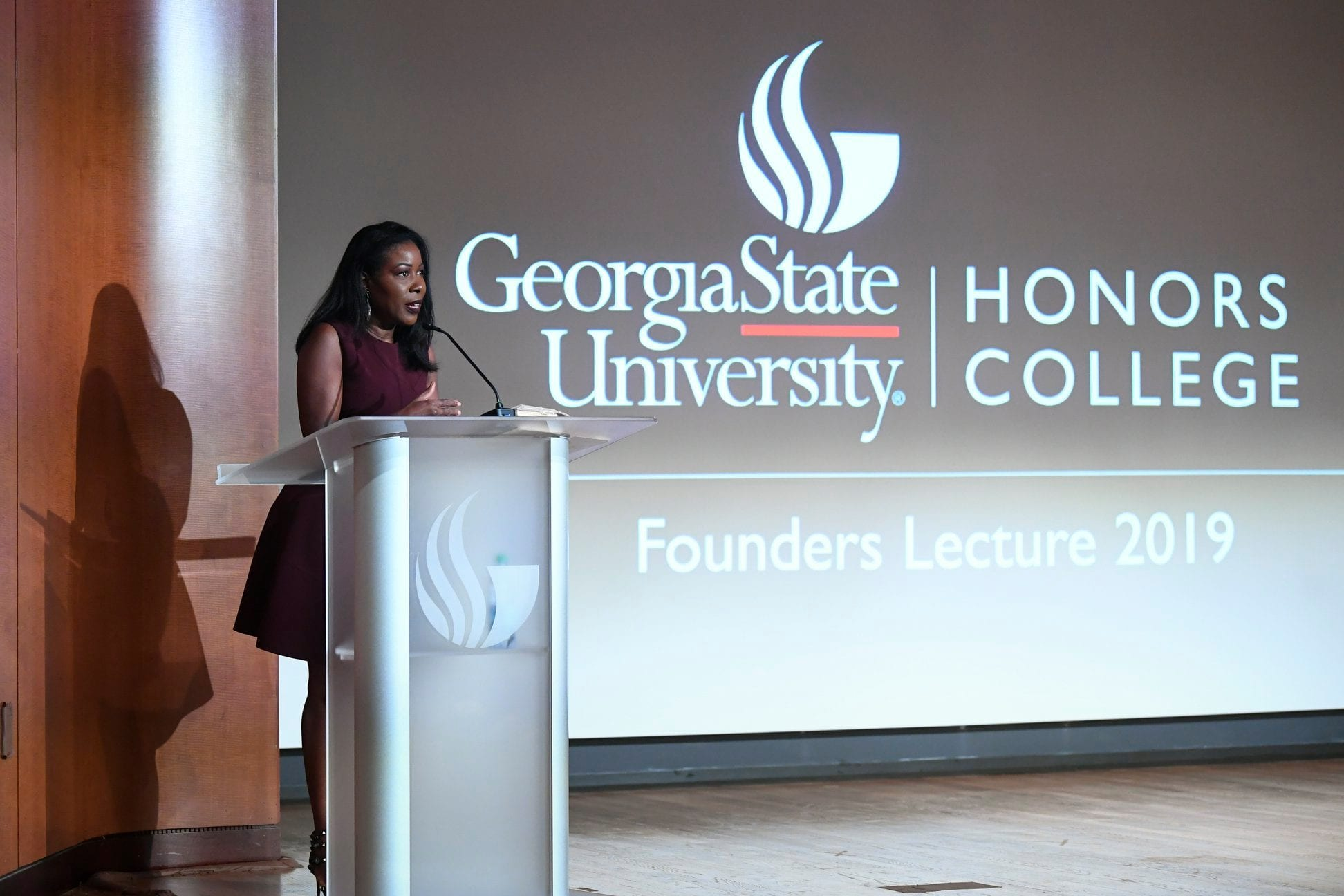 Isabel Wilkerson speaks on the Centennial Auditorium stage during the Honors College 2019 Founders Lecture