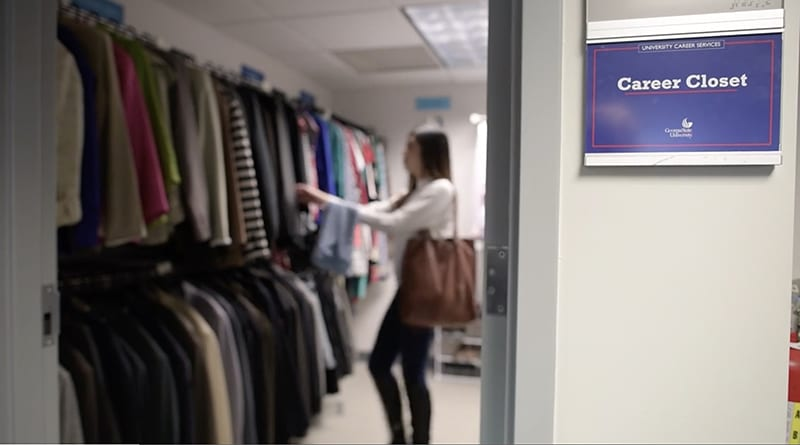 A Georgia State student shops for clothes at the new Career Closet.