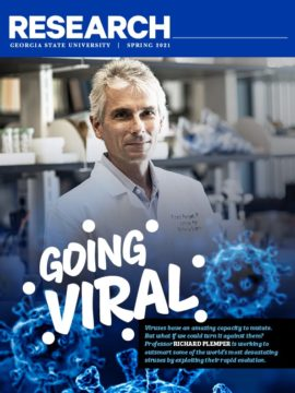 The spring 2021 cover of the Research Magazine featuring Richard Plemper in a lab coat with the title Going Viral.